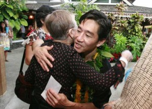 Todd Murashige hugs it out at his December 3 fundraiser