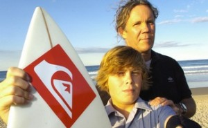A teenage surfer has escaped with superficial cuts and a ripped wetsuit after being knocked from his board by a shark